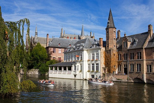Stock Photo: 1486-13381B Tourboat in a canal, Huidenvetters Square, Bruges, Belgium