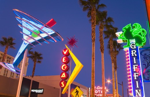 Stock Photo: 1486-13488 Neon signs lit up at night in a city, Fremont Street East District, Las Vegas, Nevada, USA