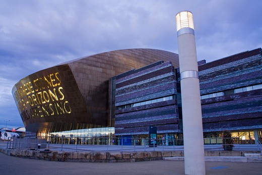 Stock Photo: 1486-13619 Building lit up at dusk, Wales Millennium Centre, Cardiff Bay, Cardiff, Wales