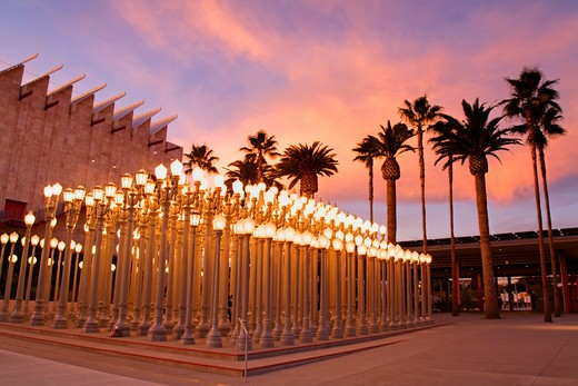 Stock Photo: 1486-13759 Lampposts lit up in front of an art museum, Los Angeles County Museum of Art, Wilshire Boulevard, Los Angeles, California, USA