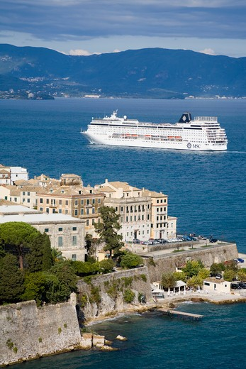 Stock Photo: 1486-14773 High angle view of a town with cruise ship in the background, Corfu Town, Ionian Islands, Greece