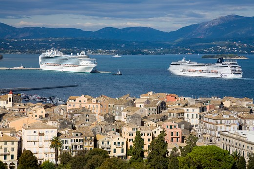 High angle view of a town with cruise ships in the background, Corfu Town, Ionian Islands, Greece : Stock Photo