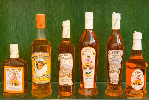 Kumquat liqueur bottles in a store, Corfu Town, Ionian Islands, Greece : Stock Photo