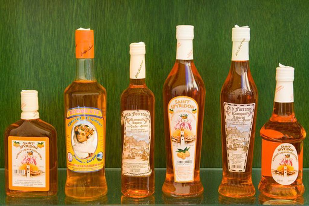 Stock Photo: 1486-14787 Kumquat liqueur bottles in a store, Corfu Town, Ionian Islands, Greece