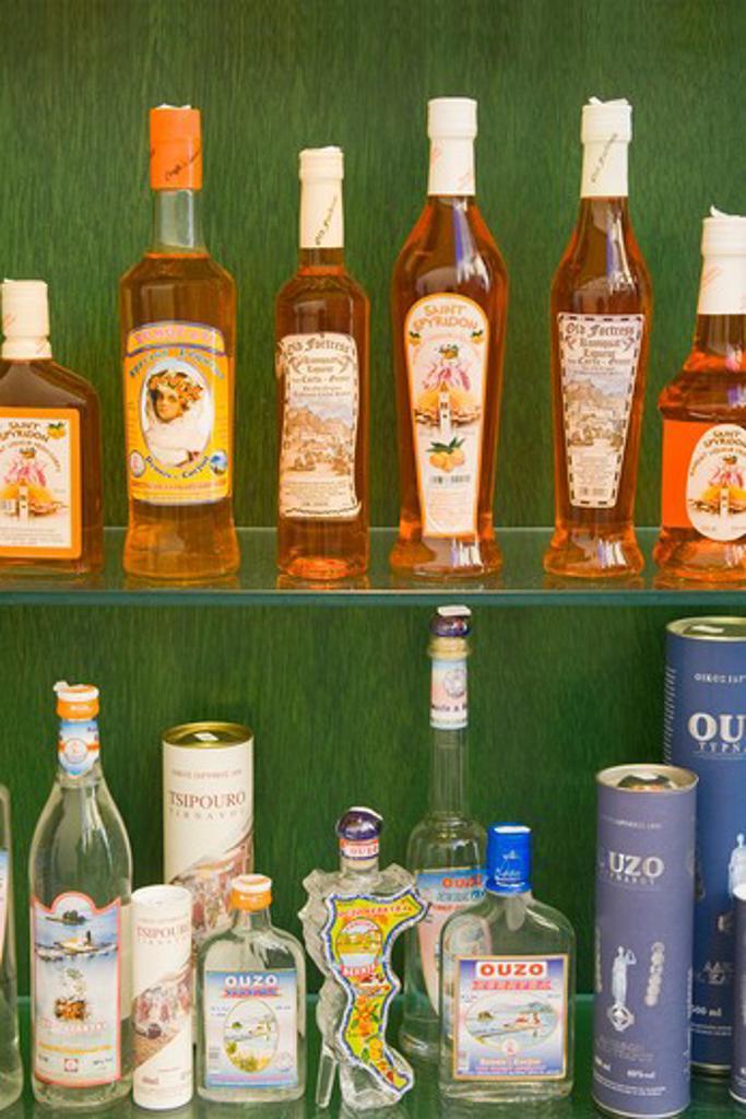 Stock Photo: 1486-14788 Kumquat liqueur bottles in a store, Corfu Town, Ionian Islands, Greece