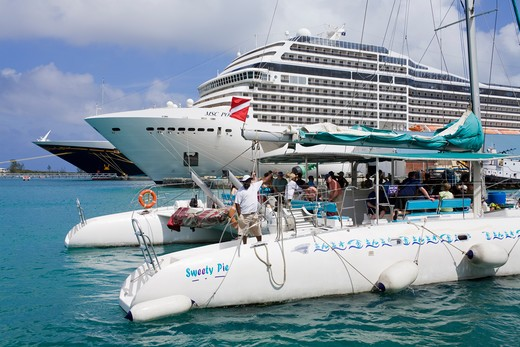 Stock Photo: 1486-15839 Catamaran and a cruise ship at a harbor in Nassau, New Providence Island, Bahamas