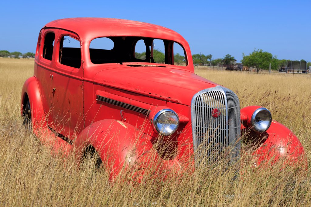 Abandoned car in field, Corpus Christi, Texas, USA : Stock Photo