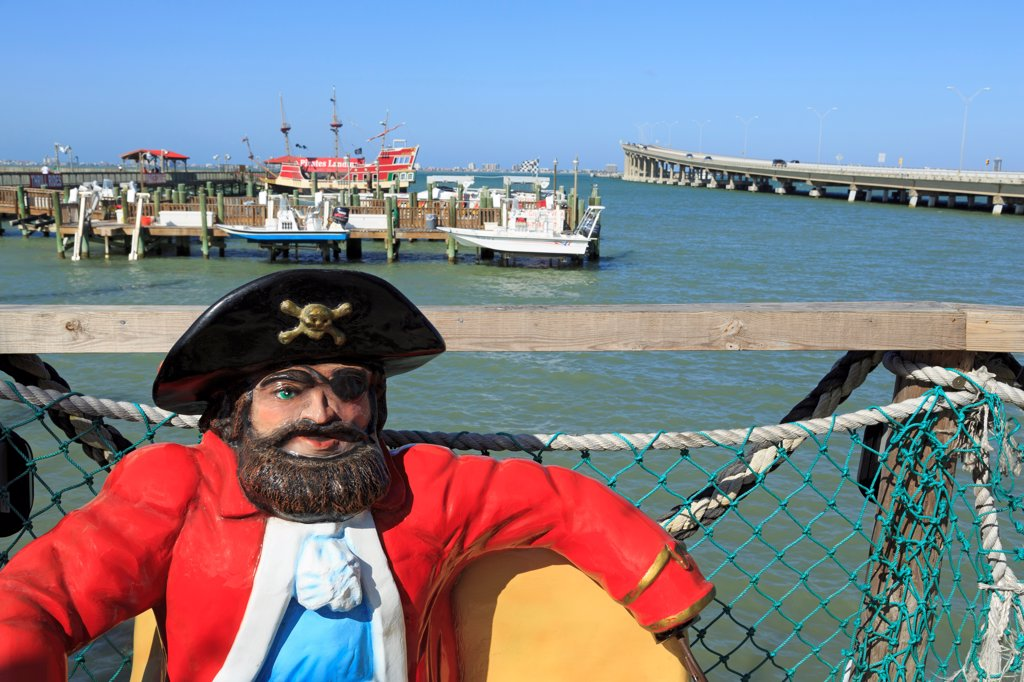 Statue of pirate with a harbor in the background, Port Isabel, Texas, USA : Stock Photo