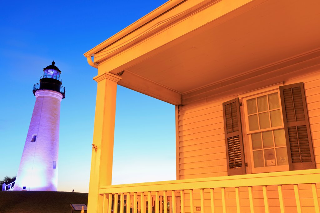 Building with a lighthouse in the background, Point Isabel Lighthouse, Port Isabel, Texas, USA : Stock Photo