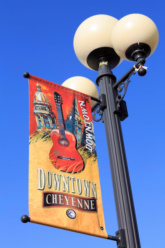 USA, Wyoming, Cheyenne, Poster on street lamp in Cheyenne Depot Plaza : Stock Photo