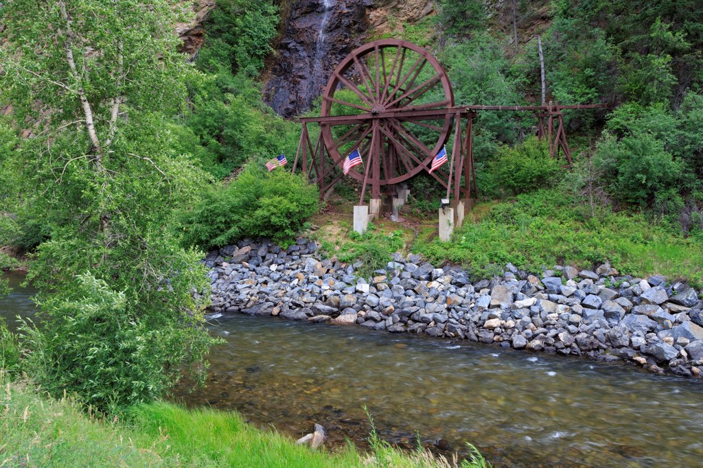 USA, Colorado, Idaho Springs, Charlie Tayler Waterwheel on Clear Creek : Stock Photo
