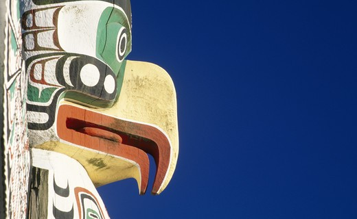 Stock Photo: 1486-1844B Canada, British Columbia, Vancouver, Stanley Park, totem pole against blue sky