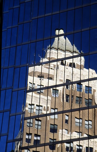 Canada, British Columbia, Vancouver, building reflecting in office building : Stock Photo