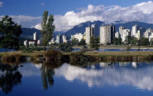 Canada, British Columbia, Vancouver, Vanier Park, lake and buildings : Stock Photo