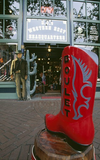 Canada, British Columbia, Vancouver, cowboy boot in front of western shop : Stock Photo