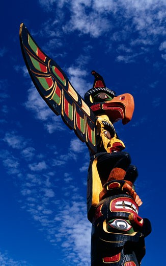 Stock Photo: 1486-1995A Low angle view of a totem pole, Thunderbird Park, Victoria, British Columbia, Canada