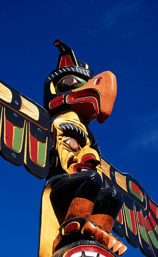 Low angle view of a totem pole, Thunderbird Park, Victoria, British Columbia, Canada : Stock Photo