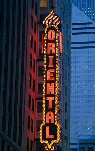 Stock Photo: 1486-231 Neon sign of a stage theatre lit up at night, Ford Oriental Theatre, Chicago, Illinois, USA