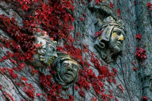Stone carved statues of faces on a wall, Adare, Ireland : Stock Photo
