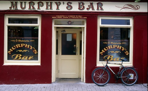 Bicycle in front of a bar, Galway, County Galway, Ireland : Stock Photo