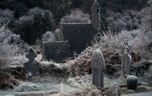 Tombstones in a cemetery, St. Kevins Church, Glendalough National Park, County Wicklow, Ireland : Stock Photo