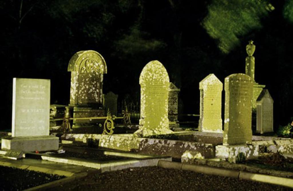Tombstones in a cemetery, WB Yeats Grave, Drumcliffe, County Sligo, Ireland : Stock Photo