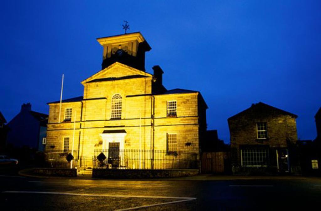 Building lit up at dusk, Lismore Heritage Center, Lismore, Ireland : Stock Photo