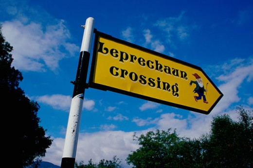 Low angle view of a crossing sign, Ireland : Stock Photo