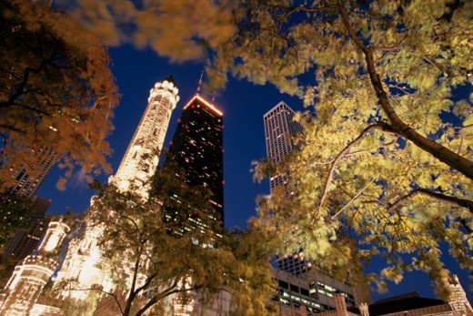 Stock Photo: 1486-3479 Low angle view of buildings lit up at night, Old Water Tower, John Hancock Tower, Chicago, Illinois, USA