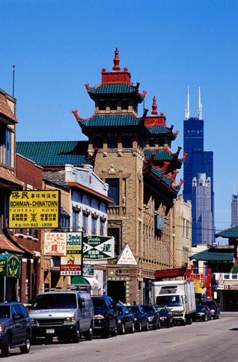 Stock Photo: 1486-3556 Cars parked in front of stores, Chinatown, Chicago, Illinois, USA
