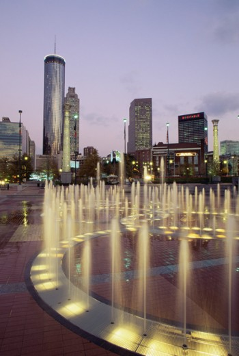 Fountains in a park with skyscrapers in the background, Centennial Olympic Park, Atlanta, Georgia, USA : Stock Photo