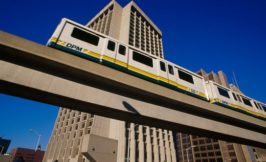 Low angle view of a passenger train on an elevated railway track, Federal Building, Detroit, Michigan, USA : Stock Photo