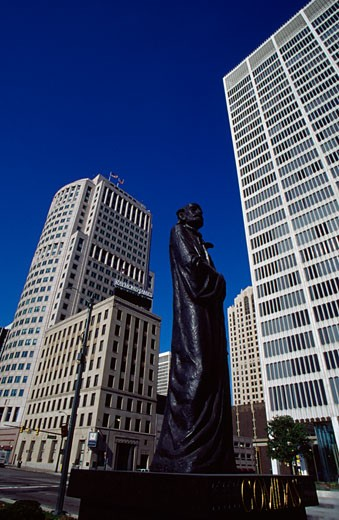 Statue in front of buildings, Comidas Statue, Detroit, Michigan, USA : Stock Photo