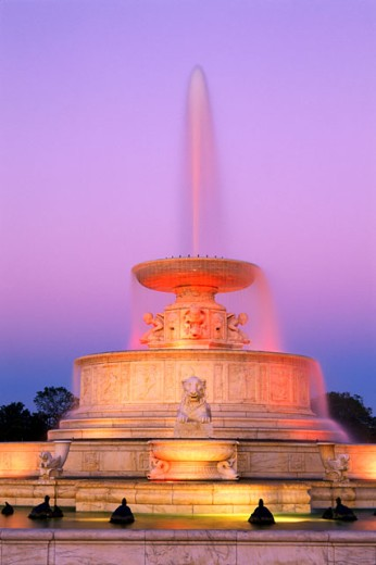 Low angle view of a fountain lit up at dusk, Scott Memorial Fountain, Belle Isle Park, Detroit, Michigan, USA : Stock Photo