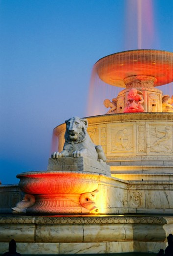 Stock Photo: 1486-448A Low angle view of a fountain lit up at dusk, Scott Memorial Fountain, Belle Isle Park, Detroit, Michigan, USA