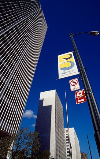 Low angle view of banners on a pole in front of buildings, Detroit, Michigan, USA : Stock Photo