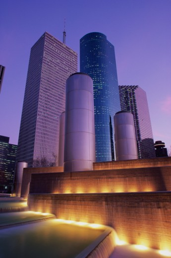 Low angle view of skyscrapers in a city lit up at night, Tranquility Park, Houston, Texas, USA : Stock Photo
