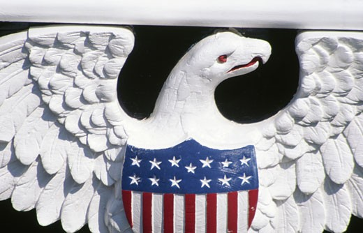 Bas-relief depicting eagle with american flag on torso : Stock Photo