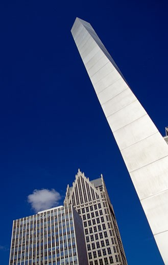 Obelisk in front of buildings, Detroit, Michigan, USA : Stock Photo