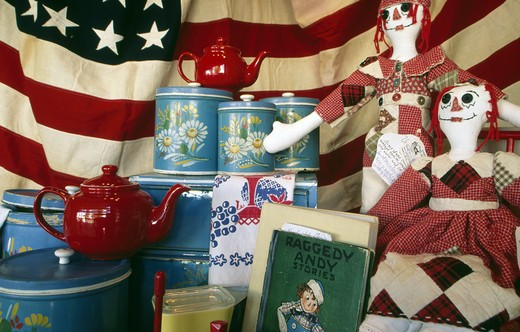 Various historic objects in museum exhibition with American flag in background : Stock Photo