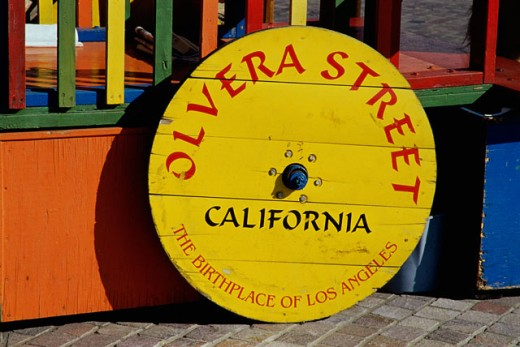 Stock Photo: 1486-6146 Wagon wheel as a sign board, Los Angeles, California, USA