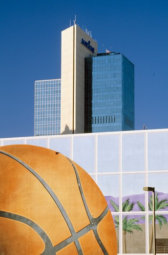 Stock Photo: 1486-6343 USA, Arizona, Phoenix, Skyscrapers with basketball painting in foreground