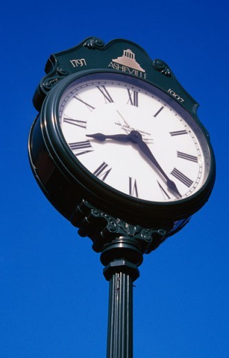 Stock Photo: 1486-7242 Low angle view of a clock
