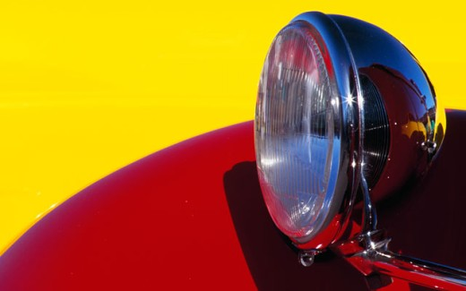 Close-up of the headlight of an antique car : Stock Photo