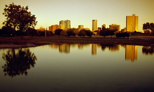 Stock Photo: 1486-732 Skyline of a city at riverbank, Trinity River, Fort Worth, Texas, USA