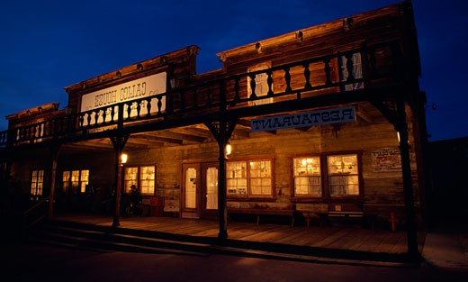 Restaurant building lit up at night, Calico, California, USA : Stock Photo