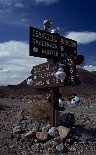 Street name signboards in a field, Teakettle Junction, Death Valley National Park, California, USA : Stock Photo