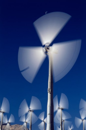 Low angle view of wind turbines spinning, Palm Springs, California, USA : Stock Photo