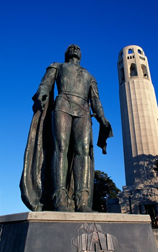 Statue of Christopher Columbus with a tower in the background, Coit Tower, San Francisco, California, USA : Stock Photo
