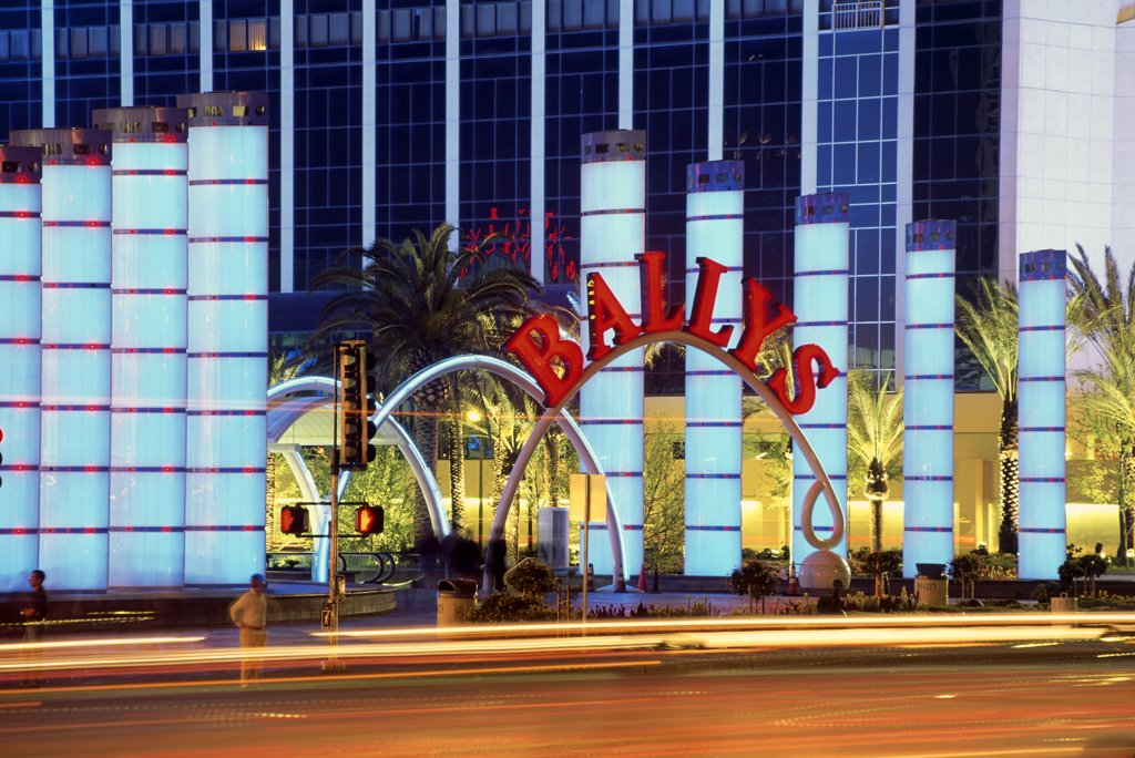 Traffic on a road in front of a hotel, Bally's Hotel and Casino, Las Vegas, Nevada, USA : Stock Photo